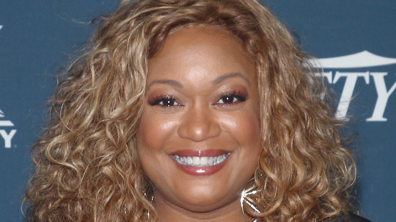 Sunny Anderson smiling and posing