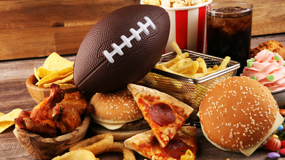 Football with Super Bowl spread of food