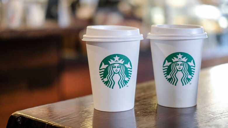 Starbucks to-go coffee cups on table