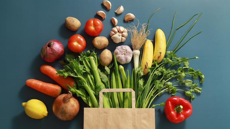 Bag with vegetables spilling out