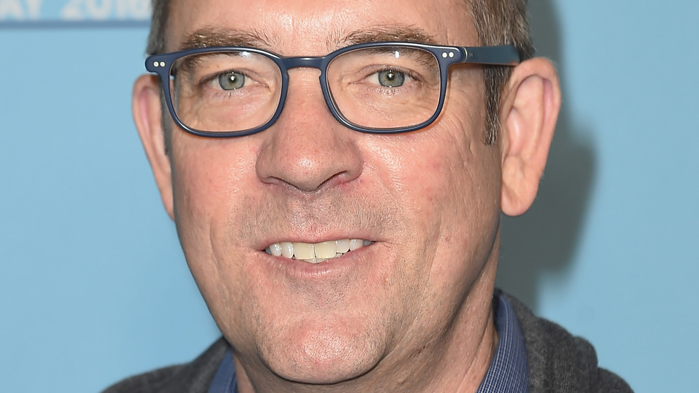 Ted Allen against blue background