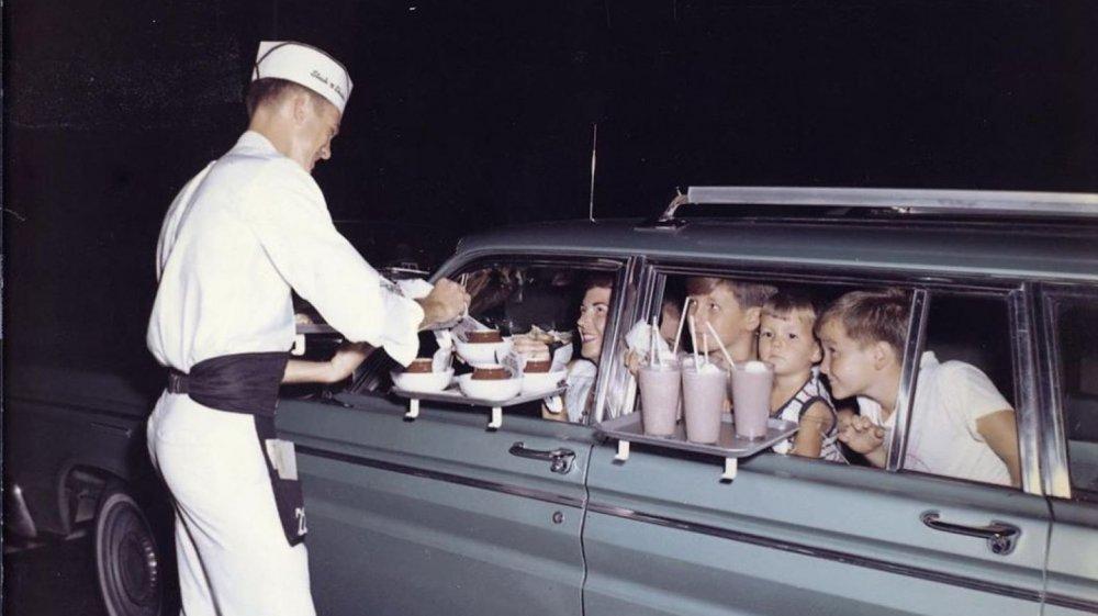 Vintage photo of family eating at Steak 'n Shake carhop