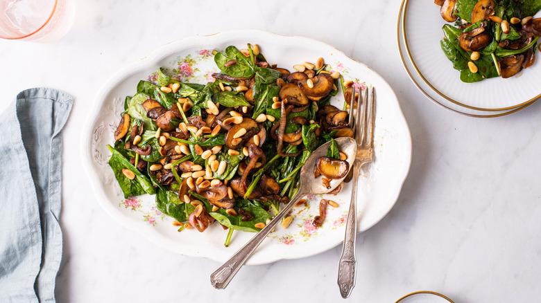 spinach salad on platter