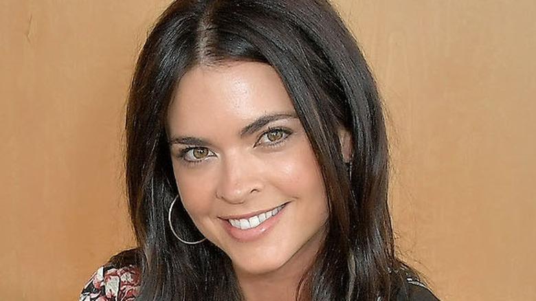 Katie Lee Biegel on orange background