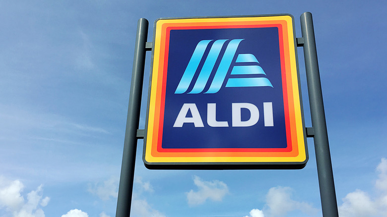Aldi sign in front of a blue sky
