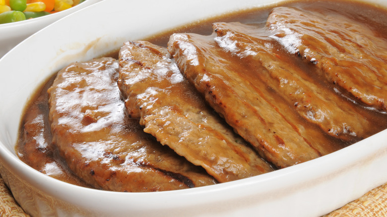 Salisbury steaks in white dish