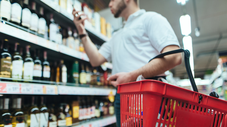 dude browsing liquor store