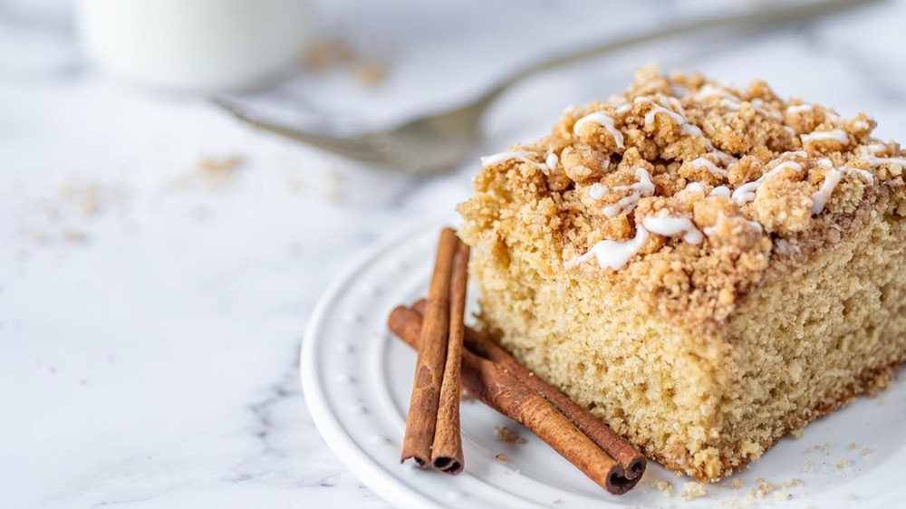white plate of cinnamon streusel coffee cake