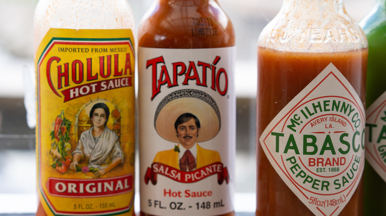 Close-up of several bottles of hot sauce