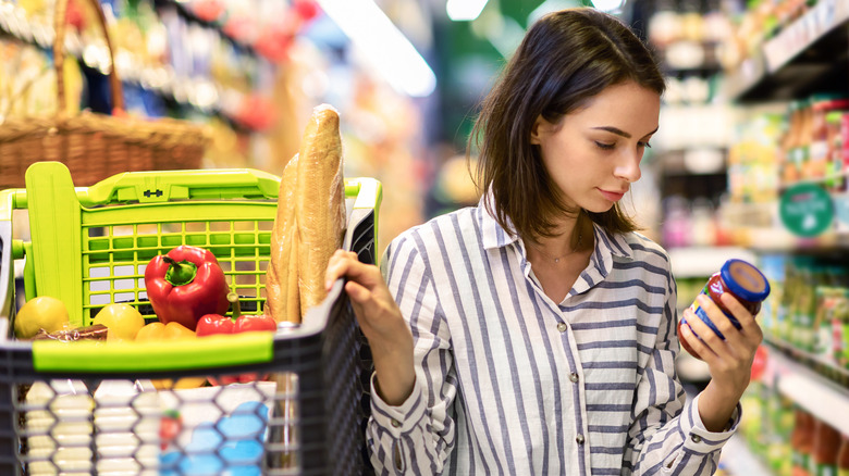 Shopper examines a grocery label