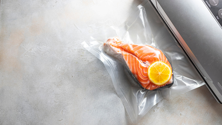 Salmon in a vaccum seal bag with lemon