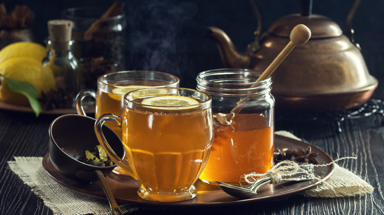 hot toddies with kettle in background