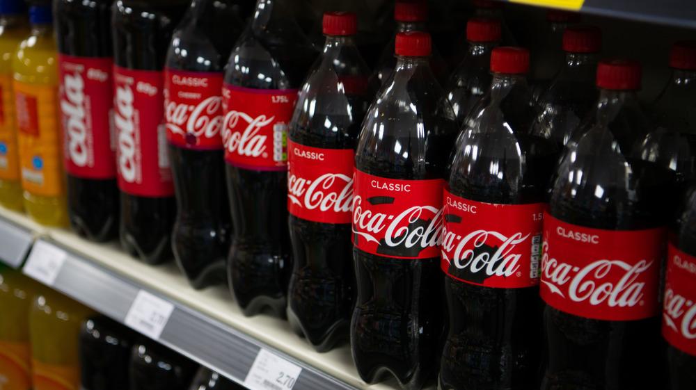 A row of Coca-Cola Bottles