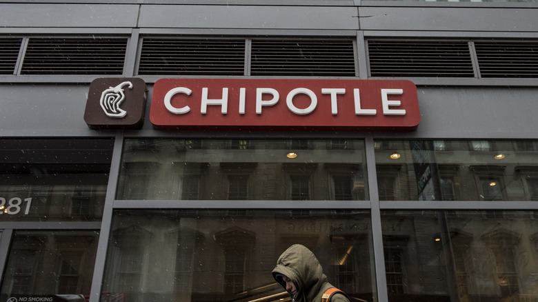 For the foreseeable future, the Chipotle sign, hanging over you ominously, will be as close as you can get to the hollowed grounds of burrito-land. Understand the sorrow of the foregrounded man whose face is downcast. Is life worth living? ... Porbably.