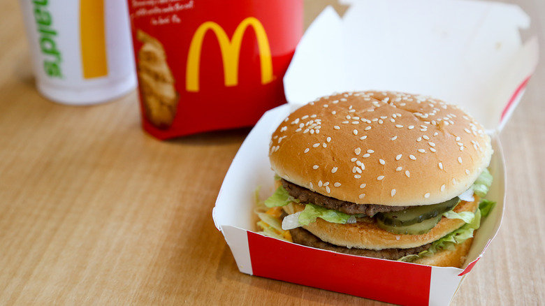 Big Mac in paper box on wood table