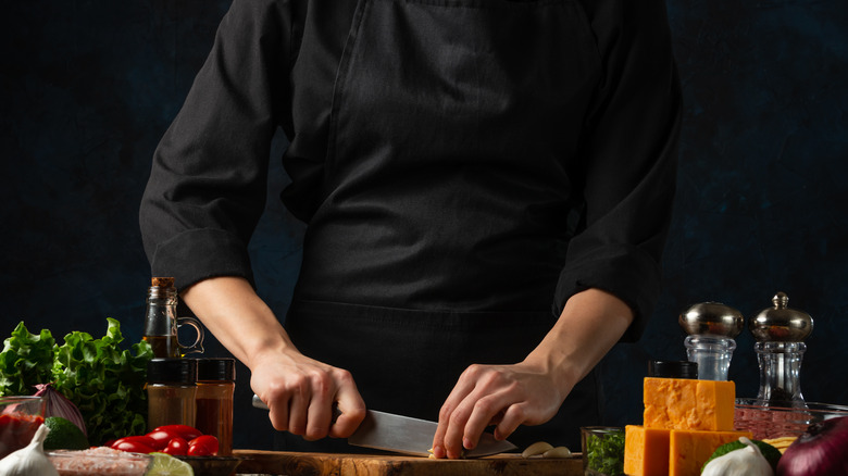 Chef using knife