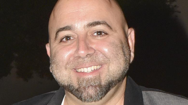 Duff Goldman smiles with beard