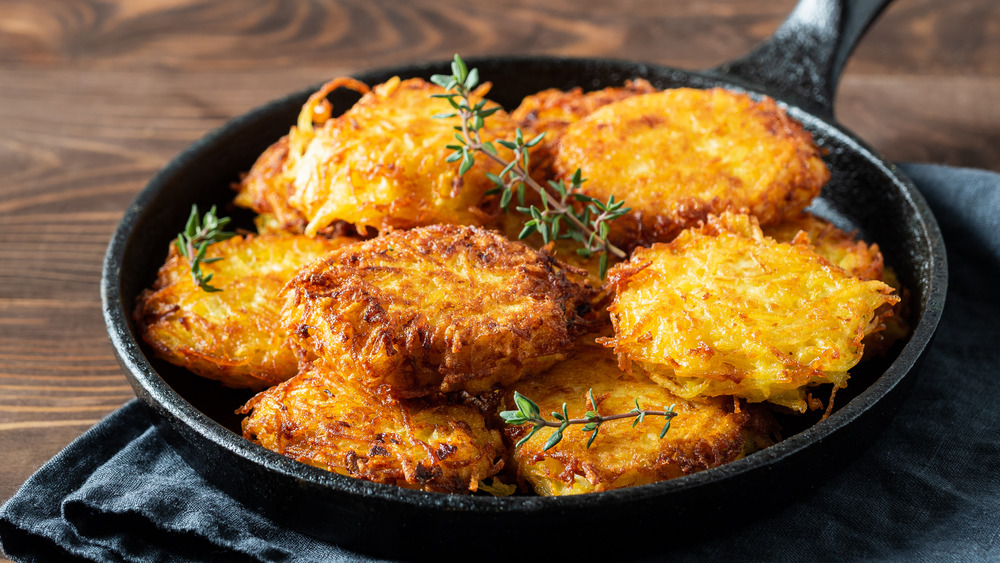 pan filled with latkes