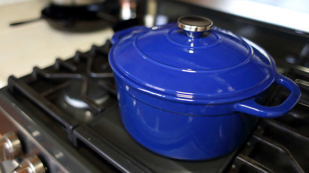 Blue Dutch oven on a black stove top
