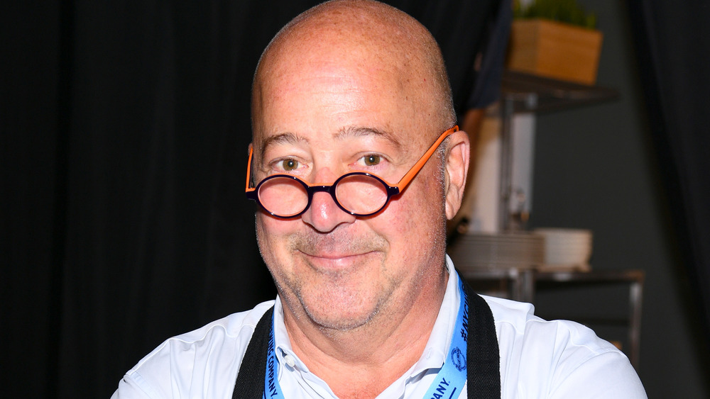 Andrew Zimmern smiling at event