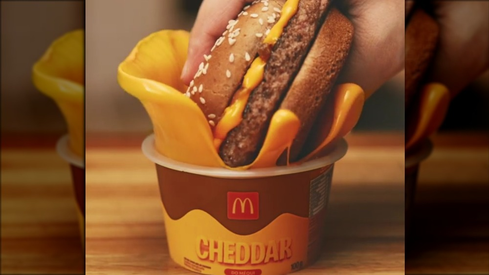 McDonald's burger dunked in cheese
