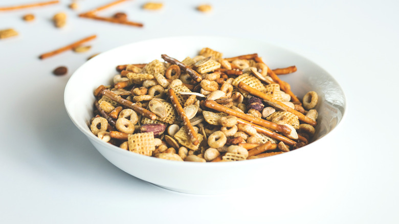 Chex Mix in white bowl