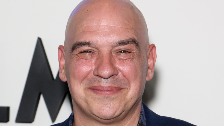 Michael Symon smiling at event
