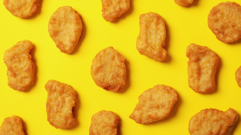 Chicken nuggets scattered on yellow surface