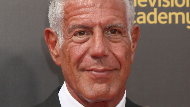 Anthony Bourdain in suit on red carpet