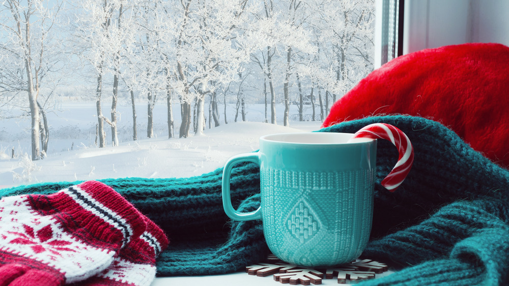 A cup of coffee with candy cane