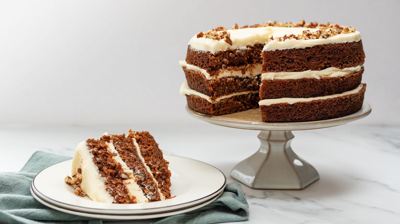 Carrot cake on a cake stand and plate