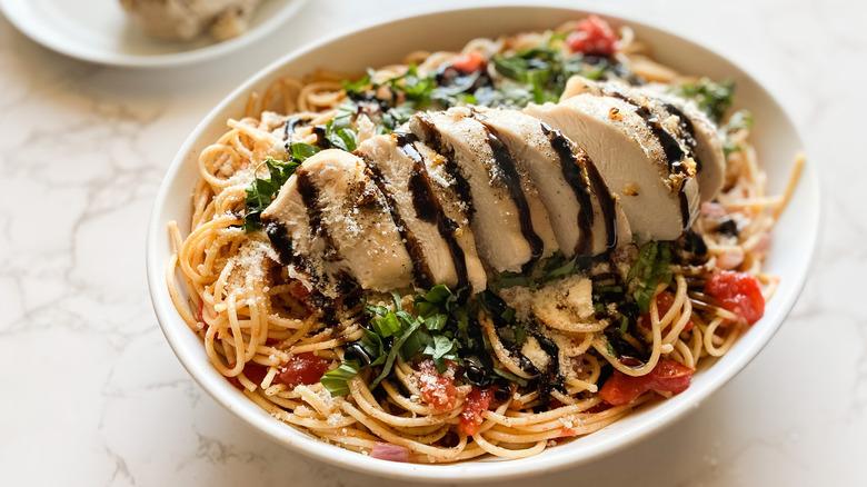 Chicken bruschetta pasta dish closeup