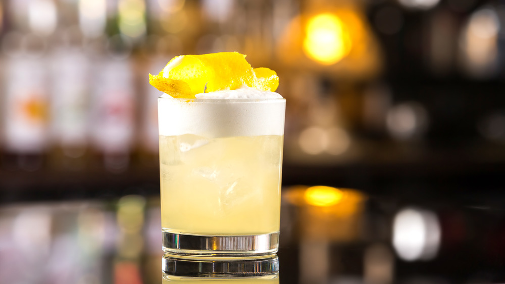 whiskey sour cocktail with garnish