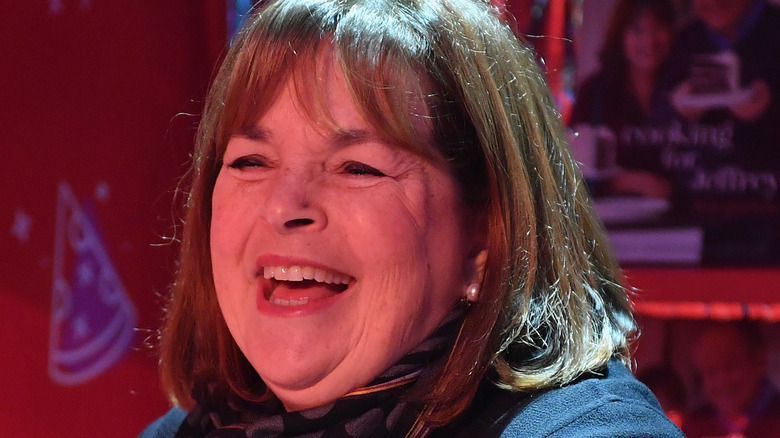 Ina Garten laughing with red background