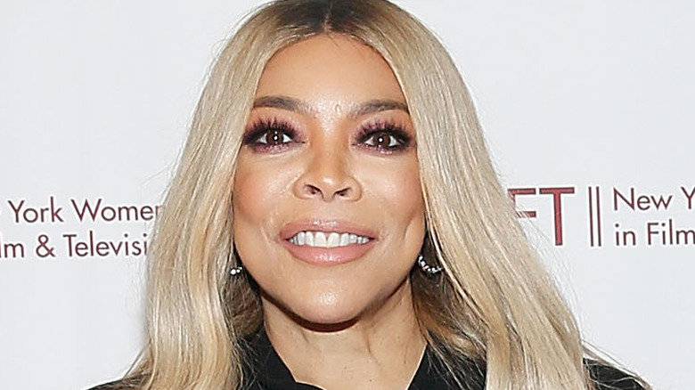Wendy Williams smiles with hair down