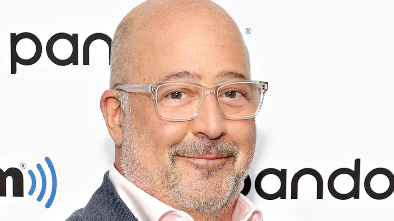 Andrew Zimmern, all smiles