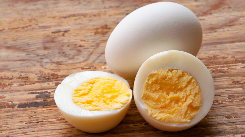 Hard-boiled eggs on wooden surface