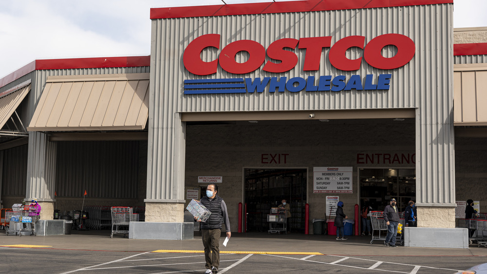 Man walking in front of Costco building