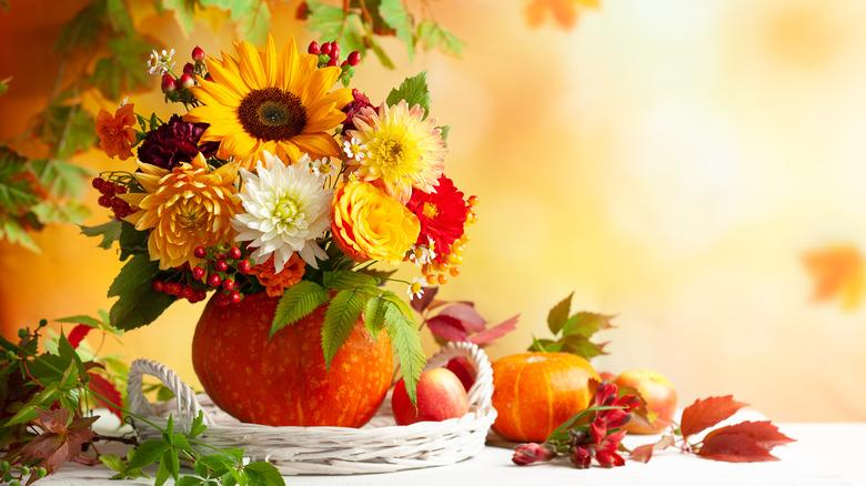 fall flower arrangement inside a pumpkin