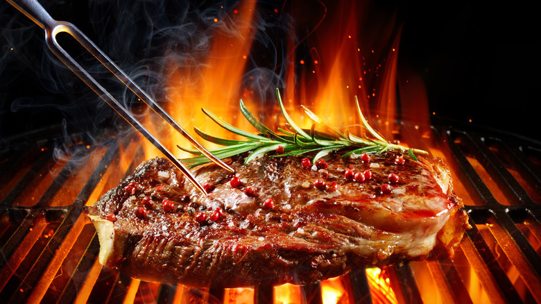 Steak on hot charcoal grill