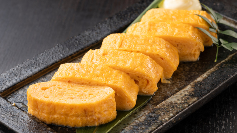 Sliced tamagoyaki on a plate
