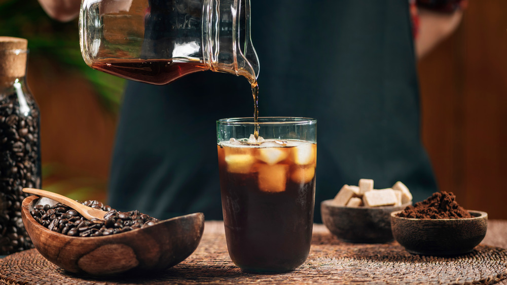 Pouring cold brew over ice