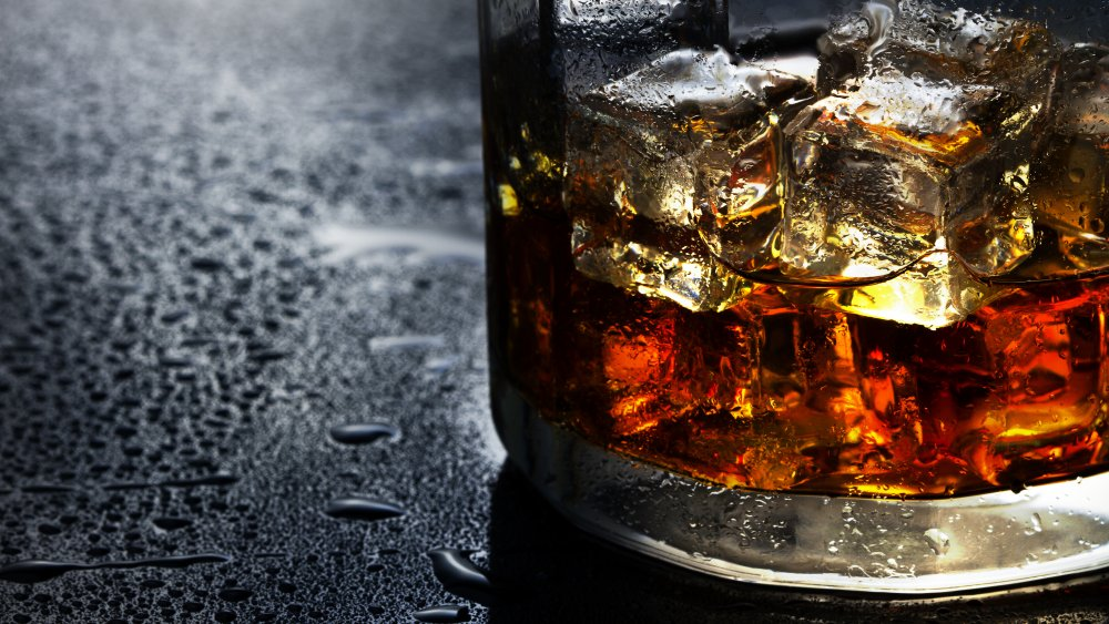 Whisky in a glass with ice cubes