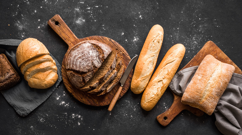 Assorted breads on cutting board