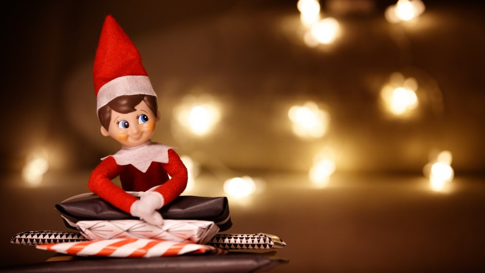 Elf on the Shelf with lights behind