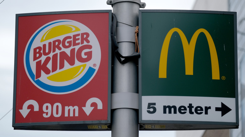 Street signs for Burger King and McDonald's