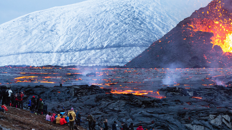 People gather to watch volcanic eruption in Iceland