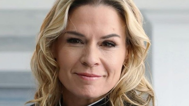 Cat Cora with a black chef's jacket
