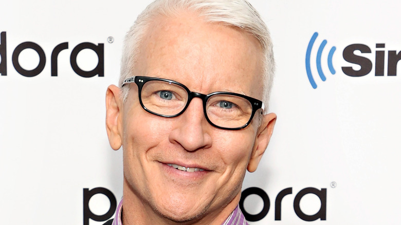 Anderson Cooper smiles with glasses