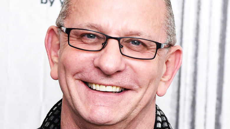 Robert Irvine smiling at event